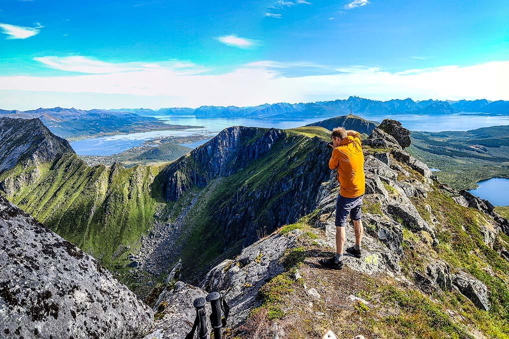 Mountain hiking across Hadseløya. Man taking picture.